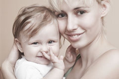 Happy Mother Holding Baby Girl Royalty Free Stock Photos