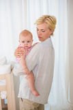 Happy mother holding baby girl Royalty Free Stock Images