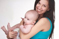 Happy mother holding baby Stock Image