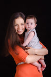 Happy mother holding a baby. Portrait of mother and baby at the hands of six mothers stock image