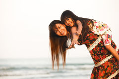 Happy mother holding her daughter Royalty Free Stock Photos