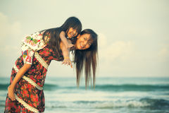 Happy mother holding her daughter Stock Image