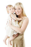 Happy mother holding one year daughter Stock Photo