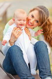 Happy mother holding smiling adorable baby girl Royalty Free Stock Image