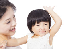 Happy mother holding smiling child baby Stock Image