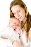 Happy mother  holding a young baby girl Royalty Free Stock Images
