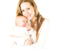 Happy mother  holding a young baby girl Royalty Free Stock Photography