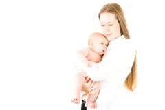 Happy mother  holding a young baby girl Stock Photos