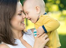 Happy mother holding a young son Royalty Free Stock Image