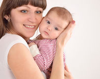 Happy mother holds on hands of the newborn baby Royalty Free Stock Photography