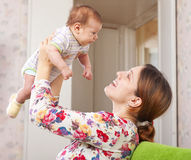 Happy mother holds to baby Royalty Free Stock Images