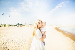 Happy mother huges baby. Mother holds child in her arms, baby hugging mom royalty free stock photo