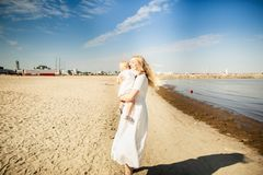 Happy mother huges baby. Mother holds child in her arms, baby hugging mom stock images