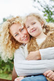 Happy mother hugging daugther stock photos