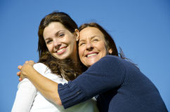 Happy mother hugging happy daughter in friendship stock images