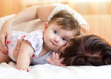 Happy mother hugging her baby daughter Royalty Free Stock Image