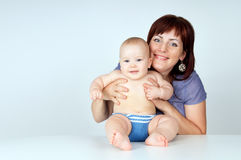 Happy mother hugging her baby. Happy young mother hugging baby Stock Images