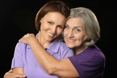 Happy mother hugging her daughter Stock Photos