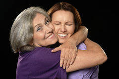 Happy mother hugging her daughter stock photography