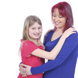 Happy mother hugging her daughter Stock Photo