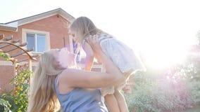 Happy mother hugging her daughter stock footage