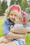 Happy mother hugging her daughter Royalty Free Stock Photo