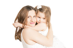 Happy Mother hugging her little pretty girl on white background. Stock Images
