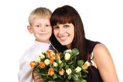 Happy mother hugging her son with flowers Stock Images