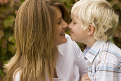 Happy mother hugging her son outside. Royalty Free Stock Photography
