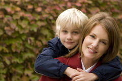 Happy mother hugging her son outside. Stock Photography