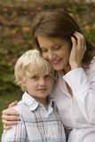 Happy mother hugging her son outside. Royalty Free Stock Photos
