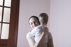 Happy Mother Hugging Son Stock Photos