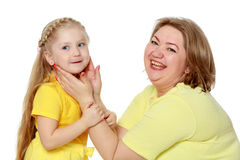 A happy mother hugs her beloved daughter. Stock Photography