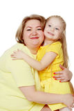 A happy mother hugs her beloved daughter. Royalty Free Stock Photos