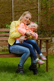 Happy mother hugs her daughter outdoor Royalty Free Stock Photo