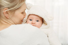 Happy mother with infant baby girl dressed in white fluffy costu Stock Photography