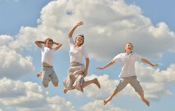 Happy mother jumping. With her sons on sky background Stock Images