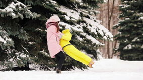 Happy mother and kid enjoy winter snowy day stock video footage
