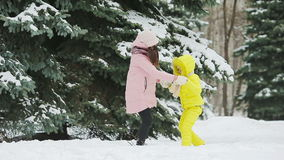 Happy mother and kid enjoy winter snowy day stock footage