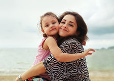 Happy mother and kid girl hugging with natural emotion smiling o Stock Photography