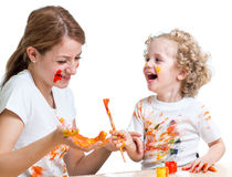 Happy mother and kid girl paint together Royalty Free Stock Image
