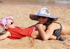 Happy mother and kid lying on Royalty Free Stock Photo