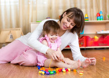 Happy mother and kid play together Royalty Free Stock Photography
