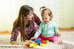 Happy mother and kid play with toys at home Royalty Free Stock Images