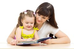 Happy mother and kid read a book together Royalty Free Stock Image