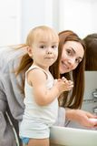 Happy mother and kid washing hands with soap royalty free stock photos
