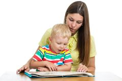 Happy mother with kid 3 years reading book isolated on white stock photo