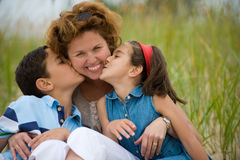 Happy mother and kids Stock Photos