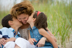 Happy mother and kids. Outdoors Stock Photography