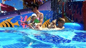 Happy mother with kids in swimming pool. Happy family on summer vacation. Active healthy lifestyle concept. stock video footage